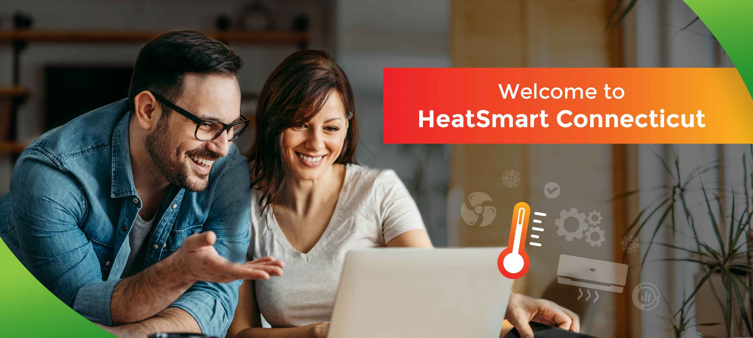 Welcome to HeatSmart Connecticut with a couple smiling while looking at a computer